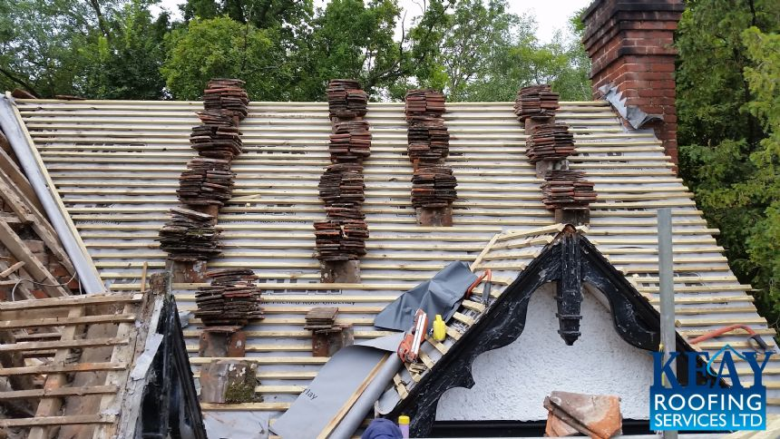 Tiles stacked on roof joists ready to be installed