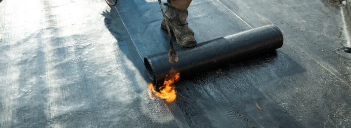 installing flat roof insulation
